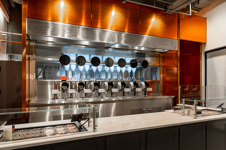 https://robert-parker-content-prod.s3.amazonaws.com/media/image/2018/05/04/117353d1f8034483afffeb5d454a154b_Spyce-Restaurant-Robotic-Kitchen-Boston-Technology-Photo+%281%29.jpg