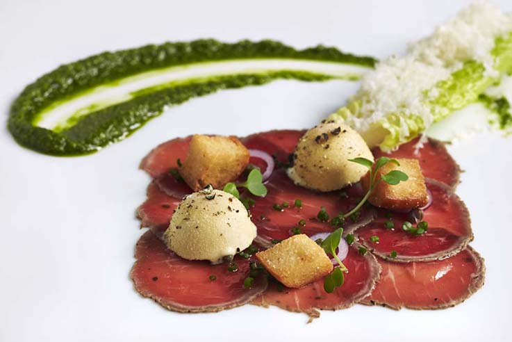 https://robert-parker-content-prod.s3.amazonaws.com/media/image/2019/08/07/8874062e132e4734a63a9d3ee8ddb41c_Carpaccio+of+Herb-Crusted+Elysian+Fields+Baby+Lamb+Loin_INLINE.jpg