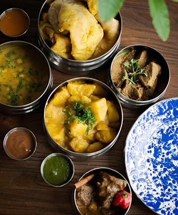https://robert-parker-content-prod.s3.amazonaws.com/media/image/2019/10/28/2aca29eaf37e40a481809e2d51d2a688_Cane-Restaurant-Tiffin-Box-SIDE.jpg